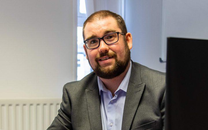 John Roberts, owner of East Yorkshire Insurance Brokers, sat at desk